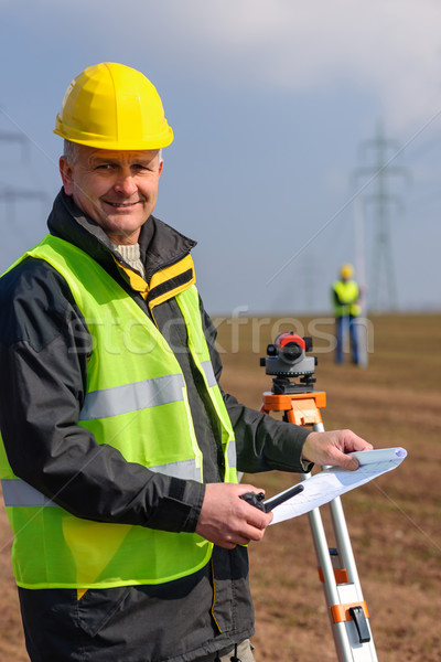 Geodesist measure land hold construction plans Stock photo © CandyboxPhoto