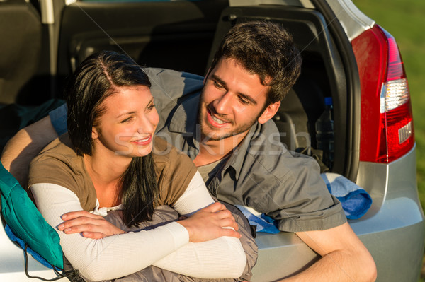 Stock photo: Camping young couple lying car summer sunset
