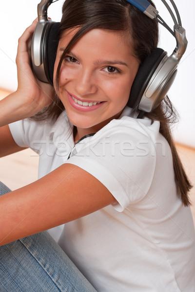 Happy teenager with headphones Stock photo © CandyboxPhoto
