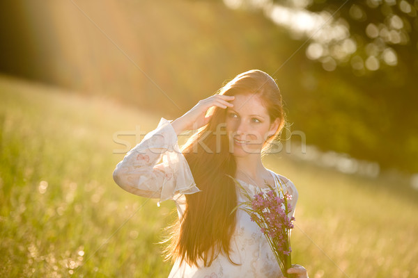 Long red hair woman in romantic sunset meadow  Stock photo © CandyboxPhoto
