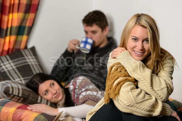 Young friends spend winter holiday cozy cottage Stock photo © CandyboxPhoto