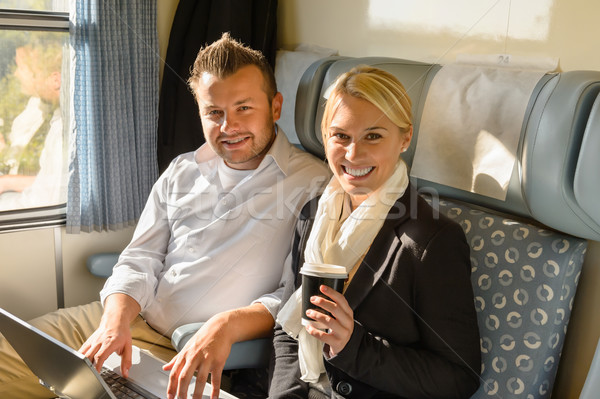Woman and man sitting in train smiling Stock photo © CandyboxPhoto