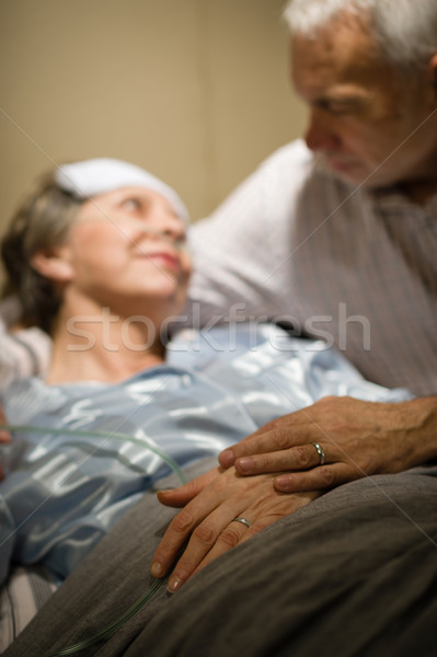 Elderly couple holding hands at clinic ward Stock photo © CandyboxPhoto