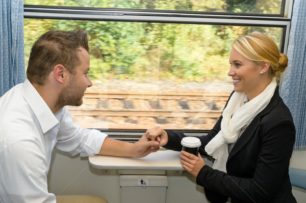Woman and man on train holding hands Stock photo © CandyboxPhoto