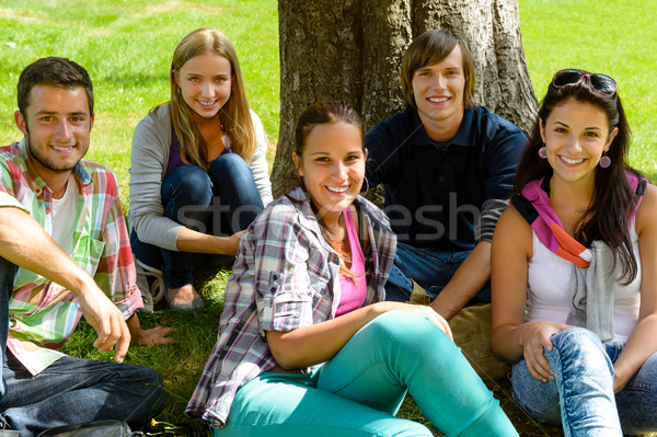 Students relaxing on meadow in park teens Stock photo © CandyboxPhoto