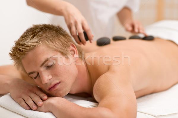 Lastone therapy - man at luxury massage  Stock photo © CandyboxPhoto