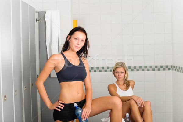 Stock photo: Locker room two sportive women getting ready