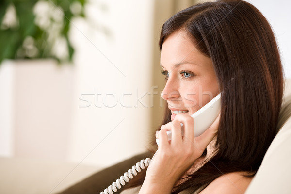 Stock photo: On the phone home - woman calling
