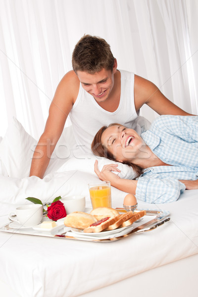 Young couple having luxury breakfast in hotel room Stock photo © CandyboxPhoto