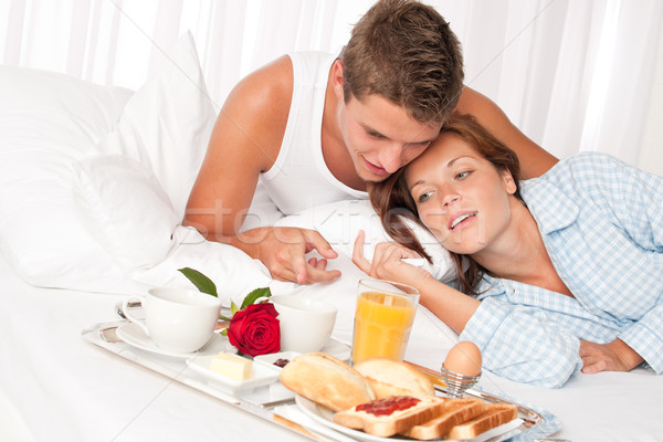 Happy man and woman having breakfast in bed together Stock photo © CandyboxPhoto