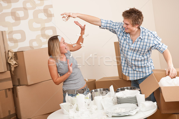 Moving house: Man and woman having fun Stock photo © CandyboxPhoto