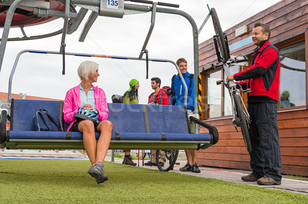 Happy couple sitting chair lift with bicycle Stock photo © CandyboxPhoto