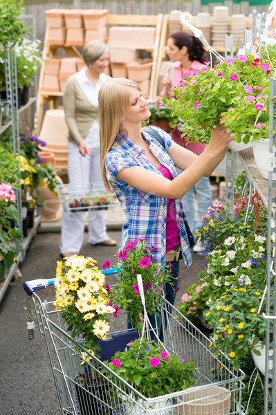 Woman shopping for flowers in garden centre Stock photo © CandyboxPhoto