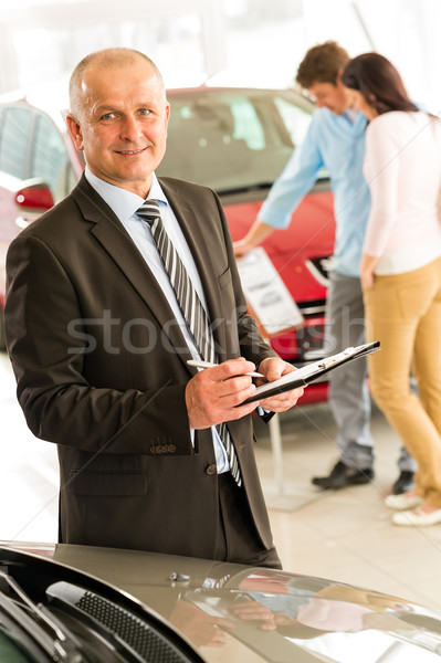 Portrait of salesman working in car dealership Stock photo © CandyboxPhoto