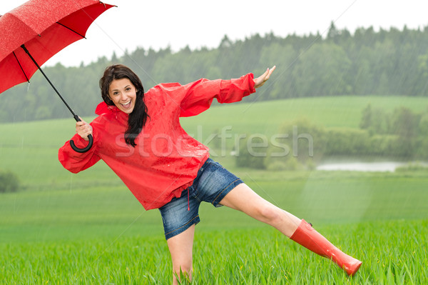 Playful happy girl in the rain Stock photo © CandyboxPhoto