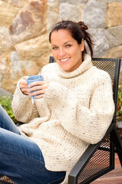 Smiling woman drinking tea patio sweater relaxing Stock photo © CandyboxPhoto