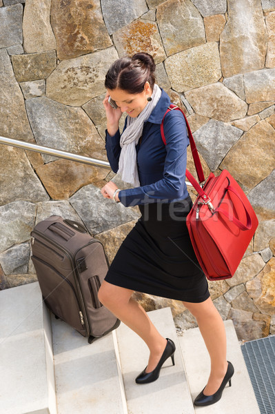 Traveling businesswoman hurried rushing climbing baggage carry-o Stock photo © CandyboxPhoto