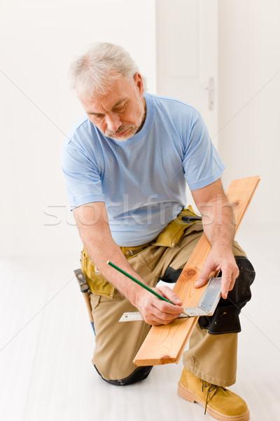 Home improvement - handyman installing wooden floor Stock photo © CandyboxPhoto