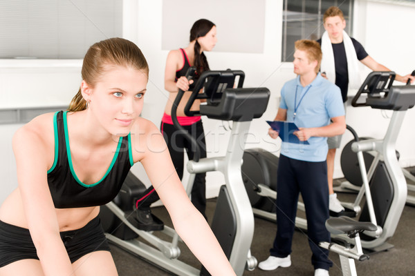 Young fitness woman doing spinning with instructor Stock photo © CandyboxPhoto