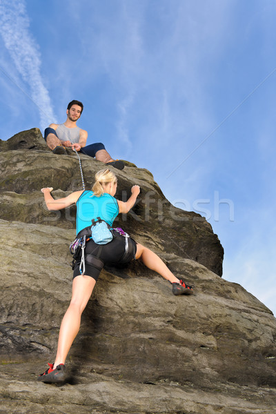Woman climbing up rock man hold rope Stock photo © CandyboxPhoto