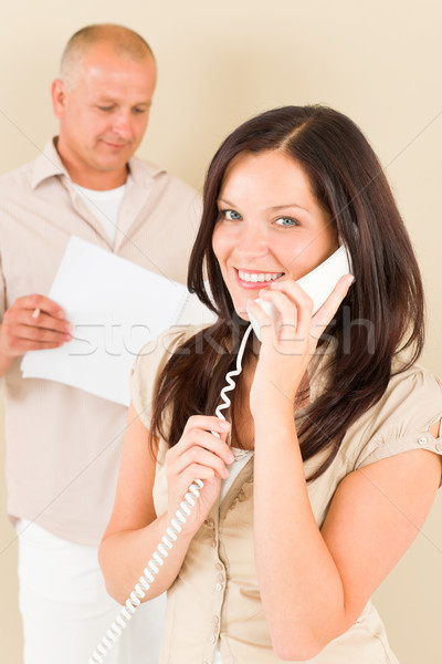 Casual businesswoman calling phone man colleague Stock photo © CandyboxPhoto