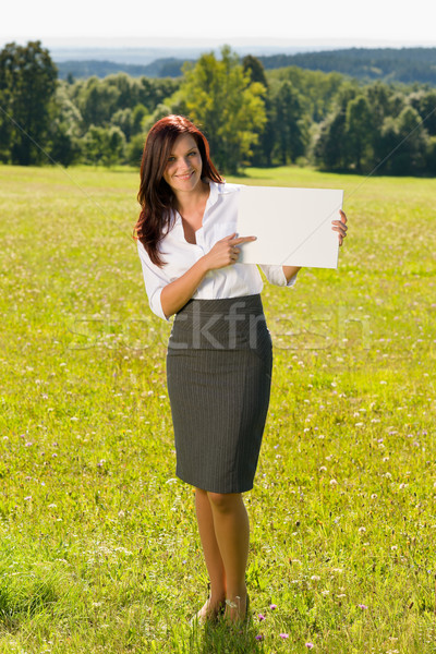 Businesswoman sunny meadow point at empty banner Stock photo © CandyboxPhoto