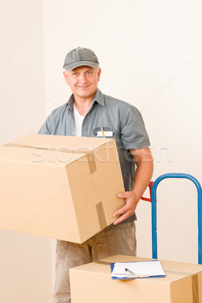 Messenger mature male courier delivering parcels Stock photo © CandyboxPhoto