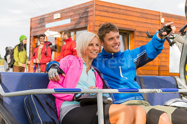 Cheerful couple sitting chair lift man pointing Stock photo © CandyboxPhoto