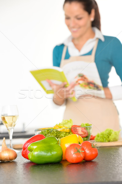 Happy woman preparing recipe vegetables cooking kitchen Stock photo © CandyboxPhoto