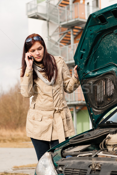 Woman looking under car hood on phone Stock photo © CandyboxPhoto
