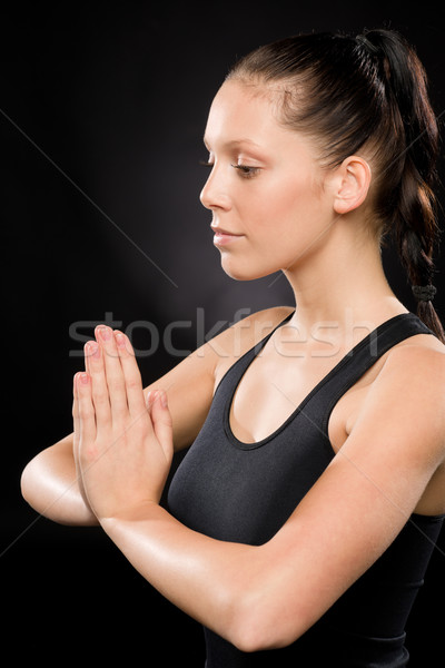 Tranquil woman performing yoga with eyes closed Stock photo © CandyboxPhoto