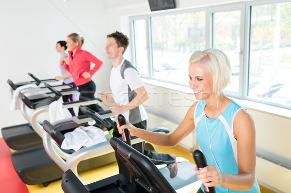 Young people on fitness treadmill running exercise Stock photo © CandyboxPhoto