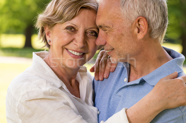 Elderly wife and husband cuddling outdoors Stock photo © CandyboxPhoto