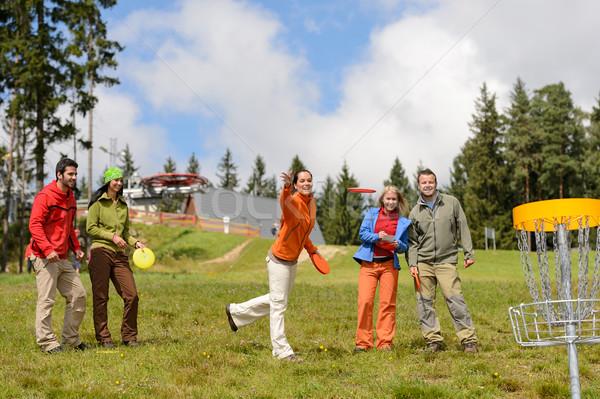 группа друзей играет Flying диска Сток-фото © CandyboxPhoto