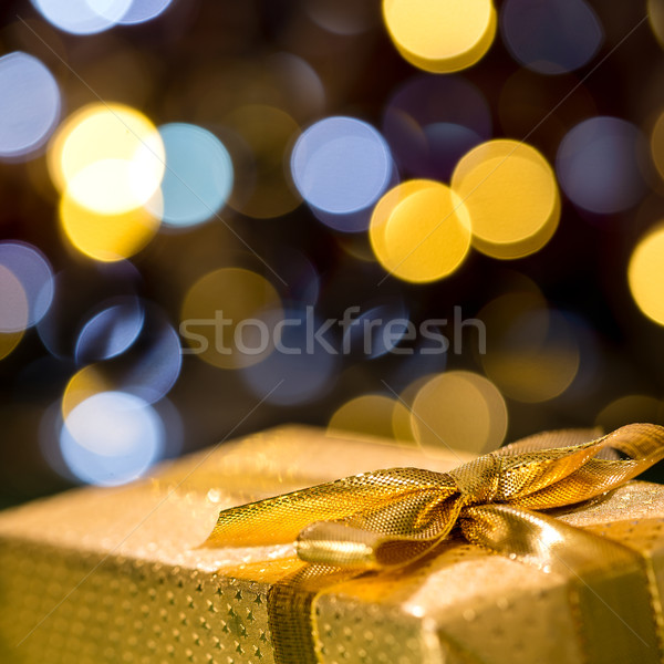 Christmas gift with sparkling lights background Stock photo © CandyboxPhoto