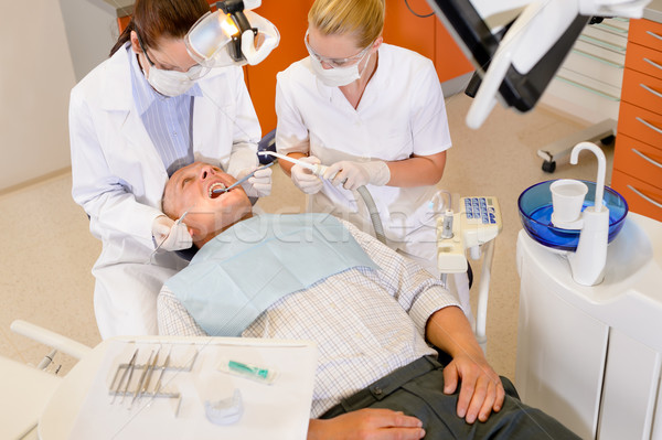 Male patient at dental checkup Stock photo © CandyboxPhoto