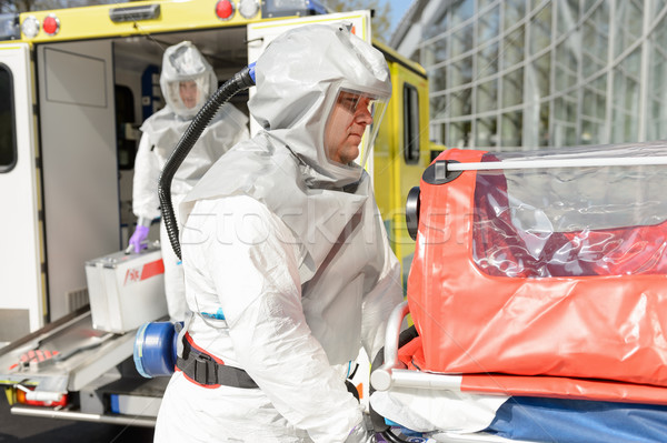 Biohazard medical team member with stretcher Stock photo © CandyboxPhoto