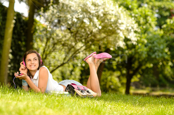Cheerful student girl lying park listen music Stock photo © CandyboxPhoto