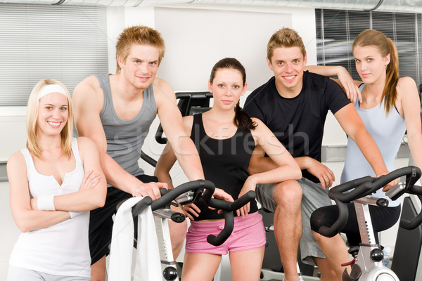 Fitness young group people at gym bicycle Stock photo © CandyboxPhoto