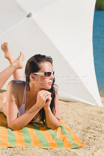 Summer beach young woman sunbathing in bikini  Stock photo © CandyboxPhoto