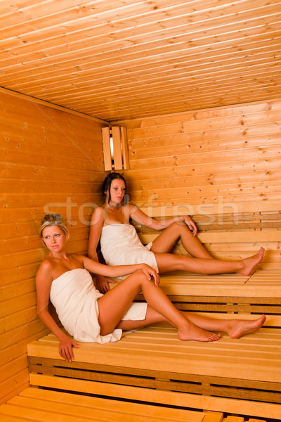Sauna two women relaxing sitting wrapped towel Stock photo © CandyboxPhoto