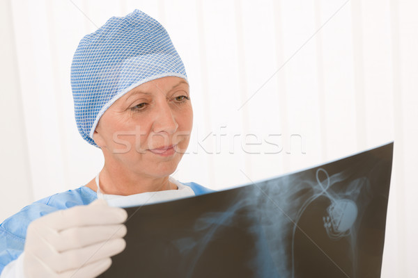 Senior surgeon female hold x-ray protective overall Stock photo © CandyboxPhoto