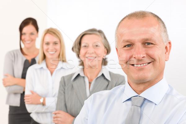 Equipe de negócios feliz homem maduro colegas em pé linha Foto stock © CandyboxPhoto