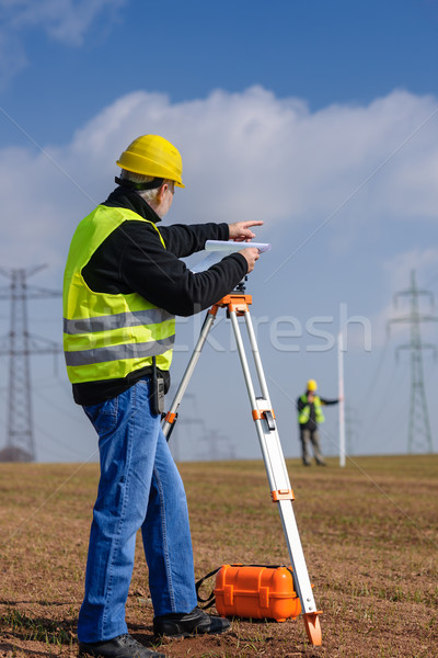 Geodesist measure land point direction Stock photo © CandyboxPhoto