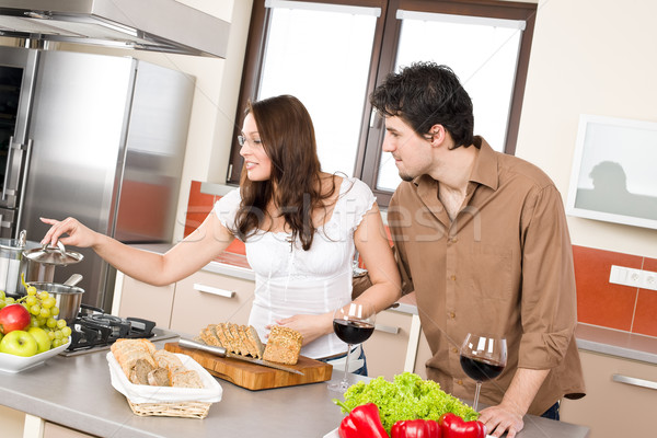 Cooking - happy couple in modern kitchen Stock photo © CandyboxPhoto