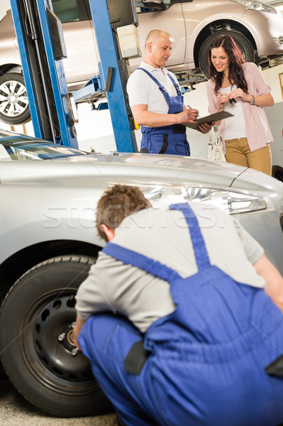 Mechanic showing paperwork to car owner Stock photo © CandyboxPhoto