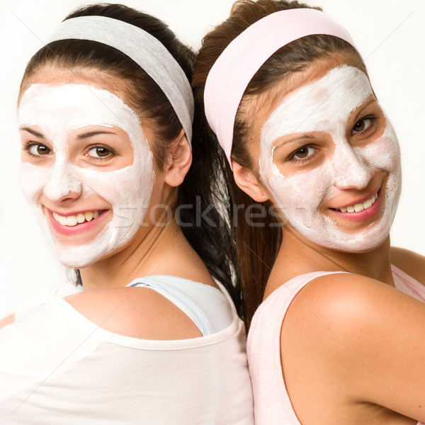 Happy caucasian girls wearing facial mask Stock photo © CandyboxPhoto