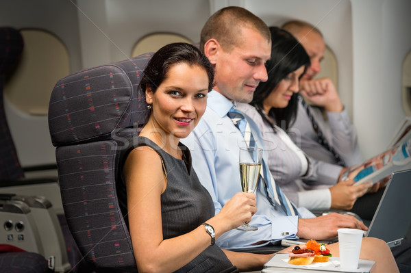 Business travel by plane woman enjoy refreshment Stock photo © CandyboxPhoto