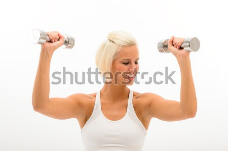 Fitness woman lifting weights looking biceps Stock photo © CandyboxPhoto