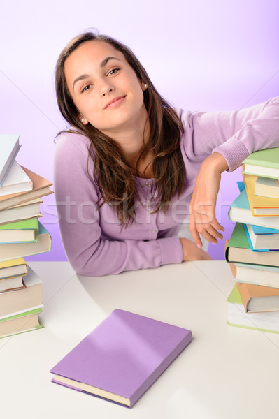 Confident student girl between stacks of books Stock photo © CandyboxPhoto